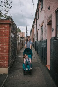 Mother pushing toddler in green baby jogger city tour pushchair by beccles.