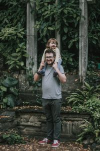 Toddler on her Father's shoulders at Norwich Plantation Garden.