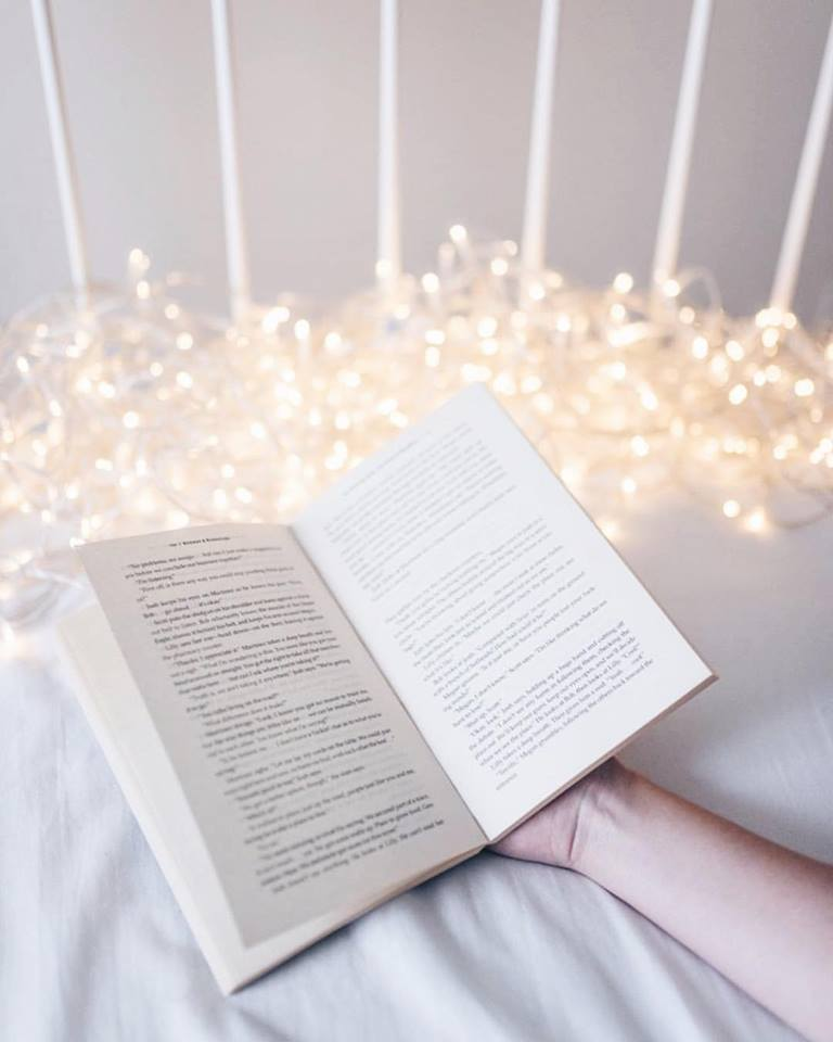 #xmashashtagchallenge an open book with fairy lights photograph