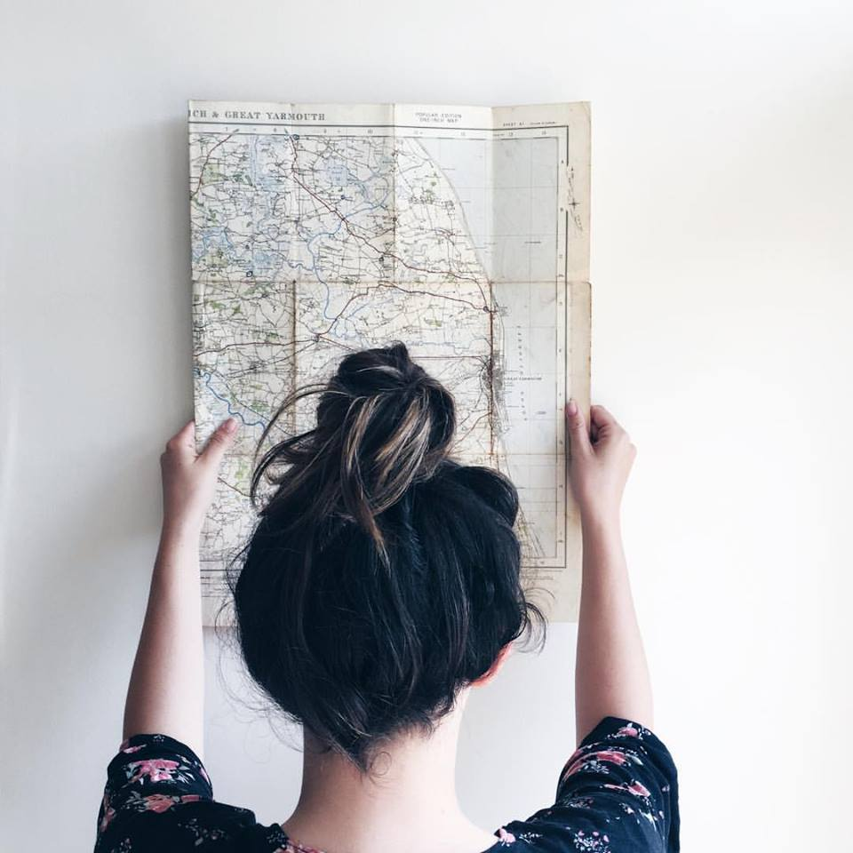 edit photographs to be light and airy girl holding up map