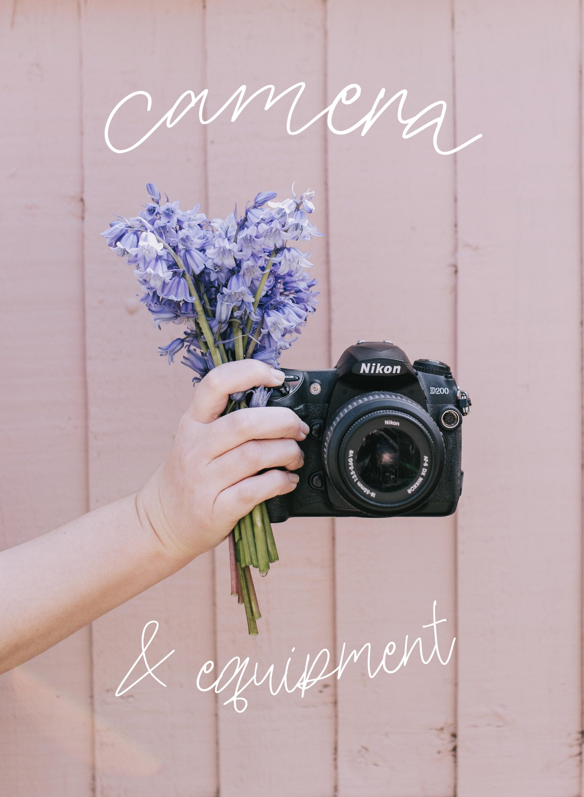 holding Nikon d200 camera with flowers