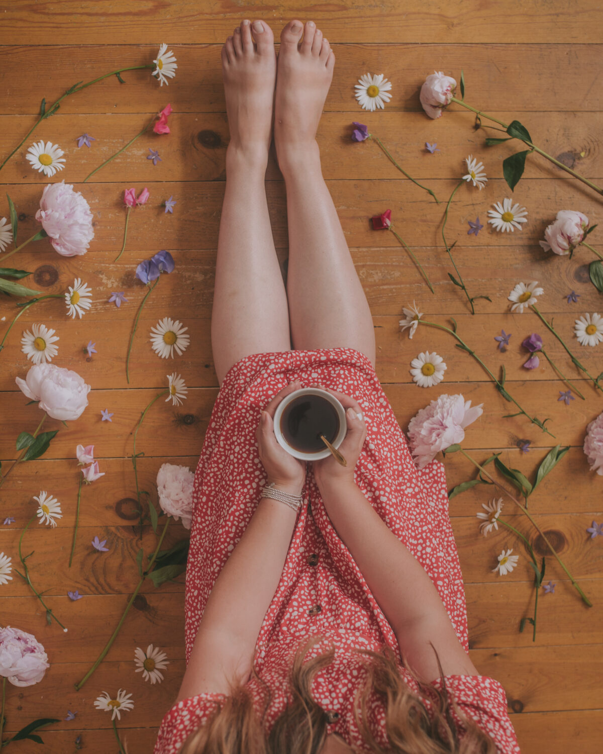 flower flatlay on floorboards with black coffee photography