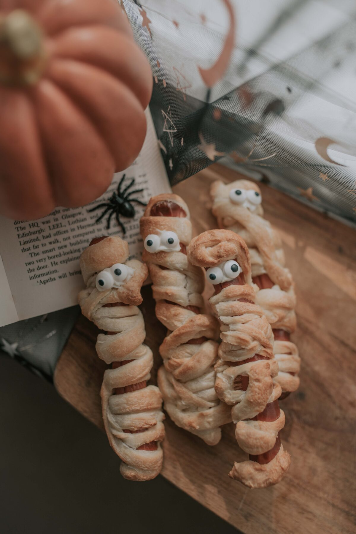 Halloween baking mummy hot dogs with edible eyes